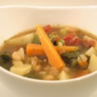 Italian Vegetable Soup with Beans, Spinach & Pesto - Cannellini beans and a plethora of vegetables - bell peppers, carrots, celery, potatoes, peas, and spinach - make this healthy soup hearty and satisfying.