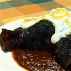 Lamb Shanks with Ancho Chile Honey Glaze - A lamb lovers dream! This is one of my favorite lamb recipes. Lamb shanks are slow roasted in a tomato base, then glazed with an ancho honey glaze, and topped with a dollop of yogurt.
