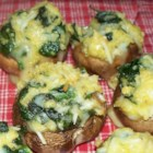 Spinach Stuffed Mushrooms - Three cheeses mix together in the spinach filling of these large appetizer mushrooms.