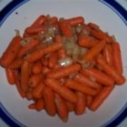 Honey Glazed Carrots - Baby carrots baked with onions, honey and spices.
