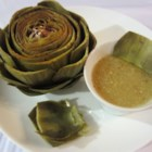 Lemon and Mustard Dipping Sauce for Artichokes - A tasty dipping sauce for artichokes that combines chicken broth, lemon juice, garlic powder, and prepared mustard, thickened with cornstarch.
