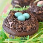 Carlee's Celebrate Spring Cupcakes - Easy and adorable chocolate cupcakes have a fluffy chocolate filling. A chocolate nest on top of each cupcake contains 3 cute little candy eggs. They're perfect for Easter.