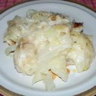 Creamed Cabbage - Steamed cabbage leaves are baked with a creamy white sauce and Romano cheese in this delicious method of preparing an old vegetable favorite.
