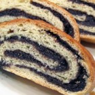 Old World Poppy Seed Roll - Homemade poppy seed filling is rolled up inside a buttery yeast dough and baked until golden brown. The recipe yields 2 filled loaves.
