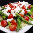 Asparagus, Feta and Couscous Salad - This fresh and simple salad featuring asparagus, tomatoes, and feta is lovely as a complement to a main course or on its own.