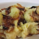 Mashed Potato, Rutabaga, And Parsnip Casserole With Caramelized Onions - Spread mashed root vegetables in a casserole and sprinkle with sauteed onion rounds.  Bake until onions are browned and crunchy.