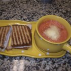 Zesty Tomato Soup for One - An easy soup to whip up when dining alone. Pamper yourself with a zesty blend of fresh tomato, onion and black pepper. Top with your favorite grated cheese.