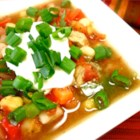 Gringo Posole - White and yellow hominy, red and green peppers, and browned pork stew meat combine to make a bright and colorful Mexican-inspired version of pozole that you make in the slow cooker.