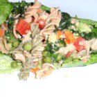 Easy Salmon Brown Rice Pasta Salad - This salmon pasta salad uses brown rice pasta in place of the traditional variety. It is then tossed in a vinaigrette dressing and a colorful array of vegetables to make a flavorful, quick meal.
