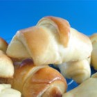 Cake Mix Yeast Rolls - Yellow cake mix added to the usual fixings for yeast rolls yields these light and delicate sweet crescent rolls sprinkled with poppy seeds.