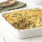 Deluxe Ham Casserole - Macaroni pasta is baked in a comforting creamy sauce with ham, peas, and Cheddar cheese. French-fried onions make a tasty, crunchy topping.
