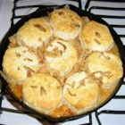 Crab Casserole - Green beans layered with crab meat, Cheddar cheese, onion rings and a tomato soup mixture - all topped with biscuits and baked.