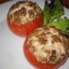 Tuna and Goat Cheese Stuffed Tomatoes - An excellent side dish or a light meal, these baked tomatoes are stuffed with a delicious mixture of goat and mascarpone cheeses, tuna, and sesame seeds, then are topped off with Parmesan cheese.