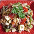 Pasta Salad with Homemade Dressing - This colorful pasta salad is packed with vegetables, pepperoni, and cheese. Toss with the simple dressing mixture, chill, and enjoy!