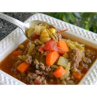 Saskatchewan City Steak Soup - A thick and hearty beef and vegetable soup made with celery, carrots, onion, cabbage, green beans, and tomatoes.
