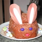 Chocolate Mousse Bunny Cake - A cute devil's food bunny cake made with a cake mix gets a fluffy chocolate frosting. The cake is cut and decorated to make a rabbit with cardboard ears and jelly bean eyes and nose.