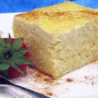 Pastia - This slow-baked creamy egg pudding is made with ricotta and pasta, and flavored with anise and vanilla.