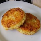 Ham Cake-ettes - Tasty ham and potato patties with green onion and Dijon mustard are rolled into panko bread crumbs and fried until golden brown. The delicious little cakes are a great way to use up post-holiday leftovers.