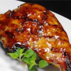 Asian Glazed Chicken Thighs - Chicken thighs marinate for an hour in an easy Asian-inspired sauce mix, then are baked and served with more 