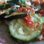 Sauteed Zucchini - This vegetable side dish features sweet onion, tomato, and zucchini seasoned with garlic and chicken bouillon.