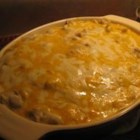 Chicken Mexicala - A layered casserole of corn tortillas, a creamy chicken and green chile pepper mixture, and Cheddar cheese. Great served with a tossed green salad, if desired.