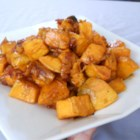 Maple Glazed Sweet Potatoes with Bacon and Caramelized Onions - Roasted sweet potatoes with crisp bacon and the mellow sweetness of caramelized onion are glazed with pure maple syrup for a holiday side dish they'll talk about for days.