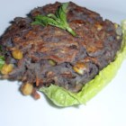 Delicious Black Bean Burgers - The black beans are joined by carrots, onion, potatoes, and corn to make vegetarian-friendly burgers.