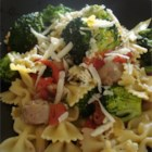 Sausage Bowties with Artichokes - Bow tie pasta is blended with Italian sausage, roasted red peppers and marinated artichoke hearts for a quick and tasty non-tomato based pasta dish.