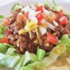 Mom's Hot Mexican Salad - Just like eating a beef taco without the tortilla. It's got lots of cumin and green chilies mixed into the ground beef and other goodies. And it 's served hot so the cheese is all melted and wonderful.