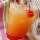 Pineapple Upside-Down Cake in a Glass - You'll be happy you sought and found cake-flavored vodka when enjoying this adult beverage with pineapple juice.