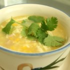 Velvety Chicken Corn Soup - Chicken broth and a can of cream of corn soup are combined with cooked chicken breast in this Chinese inspired soup flavored with sesame oil and thickened with corn starch and egg white.
