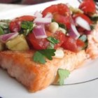 Chilled Salmon With Summer Tomato Salsa - Succulent salmon fillets are topped with a tantalizing salsa featuring avocado, tomato, and corn.