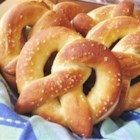 Buttery Soft Pretzels - These warm and buttery, homemade soft pretzels can be topped with sea salt for a savory snack or cinnamon and sugar for a sweet treat.