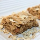 Banana Wake-Up Bars - Simple banana bars made with brown sugar, peanut butter, rolled oats, and wheat germ are an easy way to start your day or take breakfast with you.