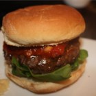 Simple Lasagna Burgers - Leftover Italian sausage and ricotta cheese combined with a craving for a juicy burger were the inspiration for this ricotta stuffed burger topped with spaghetti sauce and fresh spinach leaves.
