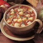 Spicy Potato Soup II - Browned ground beef is cooked with tomato sauce and cubed potatoes in a broth seasoned with hot pepper sauce and onion.