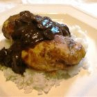 Chicken Marsala Over White Rice - Chicken breast cutlets are lightly fried, then finished in a savory mushroom and red wine sauce. This meal is easy enough for a weeknight, but elegant enough to impress company. Serve over hot cooked rice.