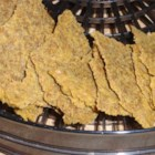 Cheezy Flax Crackers - Raw vegan crackers have a tangy flavor reminiscent of cheese from cashews, flaxseeds, red bell pepper, and lemon juice. The combination is dehydrated to make a crisp cracker.