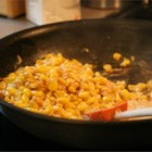 Creamy Skillet Corn - This is one of the most popular corn dishes during Thanksgiving and Christmas. It is not your traditional boring old corn. This recipe includes butter, cream and shallots. I always get rave reviews when I make this.