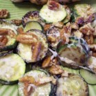 Zucchini and Pecan Saute - Slices of zucchini are sauteed in butter and then quickly tossed with warm pecans and grated parmesan cheese. Serve alone, or top a nicely-baked potato with this yummy saute.