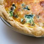Spinach and Mushroom Quiche with Shiitake Mushrooms - Spinach, shiitake mushrooms, broccoli, and sharp Cheddar cheese lend their flavors to a savory egg quiche that's ready in about an hour. A little bit of turkey bacon adds a smoky taste.