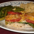 Pork Chops with Tomatoes and String Beans - Pork chops are seared on the stovetop and topped with a layer of cheese and tomatoes, then baked on a bed of fresh string beans. Great with baked potatoes.