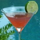 A Perfect Margarita - A festive mixture of tequila, orange liqueur, raspberry liqueur and lime juice is shaken together with ice and served in a salted glass.