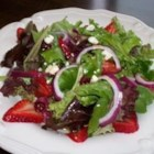 Strawberry Fields - Baby greens are tossed with strawberries, cranberries, and onion all of which are drizzled with a red wine vinaigrette.