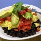 Black Bean Breakfast Bowl - This quick and easy breakfast is loaded with protein and flavor from layers of black beans, scrambled eggs, avocado, and salsa.