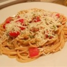 Italian Tomato Pasta Salad - Angel hair pasta tossed with zesty Italian dressing and chopped tomatoes.