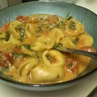 Spinach Tomato Tortellini - An old boyfriend's mother used to cook this for me whenever I ate over. Cheese tortellini are served in a creamy tomato and spinach sauce. I love it!