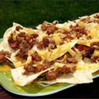 Jen's Nachos - Barbecue sauce is the surprise ingredient here--it's sauteed with ground beef and more traditional nacho toppings for a tangy twist on this everyday dish.
