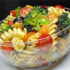 Pasta Salad - The veggies match the colors in the tri-colored pasta. And the dressing is real zesty and spicy. So when all three  - pasta, veggies and dressing - come together, you have a festive, tasty and beautiful salad for six.