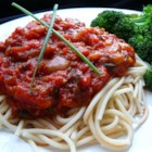 Stephanie's Freezer Spaghetti Sauce - It took all summer to grow your tomatoes, now use a slow cooker to make them into a versatile tomato sauce flavored with sauteed onion, garlic and bell pepper, and seasoned with oregano, basil, parsley, sugar and tomato paste.